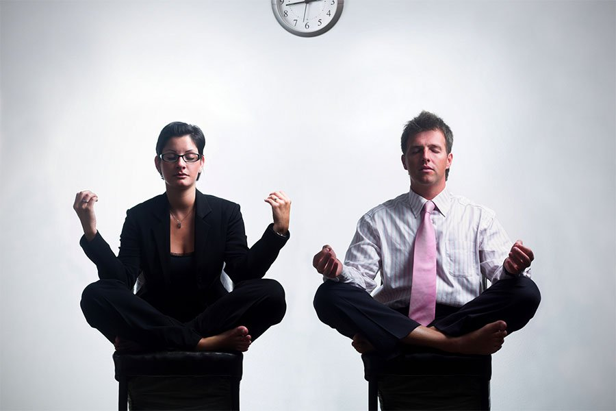 2 business people meditating