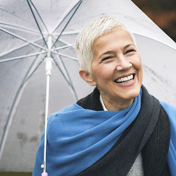 happy senior woman with umbrella