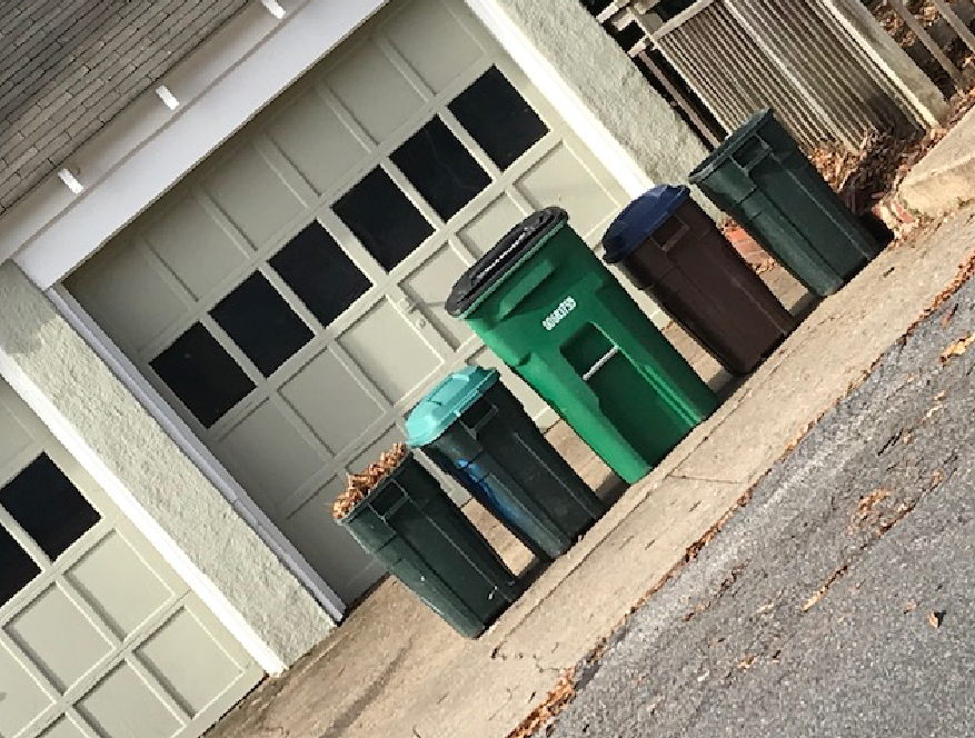 row of garbage cans